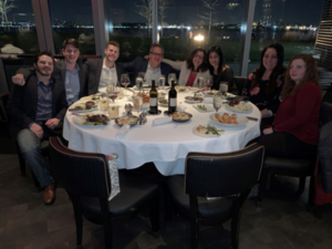 Group of people at dinner table at event
