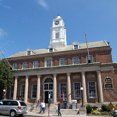 Plymouth Post Office building with brick facade, columns and clock tower fuller restored with help of federal tax credits