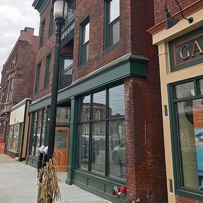Classic Greek Revival building converted to apartments using tax credits in Gardner, Massachusetts